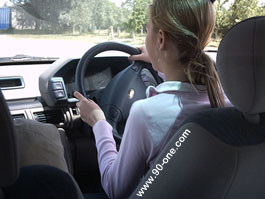 Student taking the wheel on private ground with one of our teaching staff