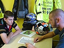 Classroom session explaining the requirements for the motorcycle test